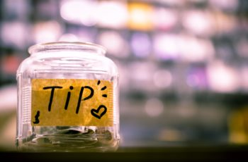 A tip jar with a blurry background